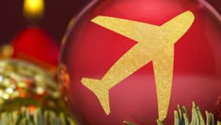An airplane Christmas ornament for holiday travel