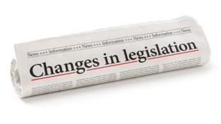 newspaper headline about changes in legislation