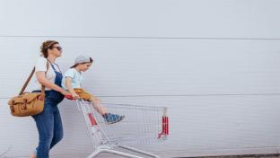 mom pushing shopping cart